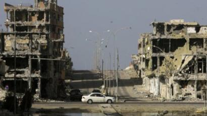 Destroyed buildings stand in Sirte's sector 2 neighbourhood on November 6, 2011 (AFP Photo / Joseph Eid)