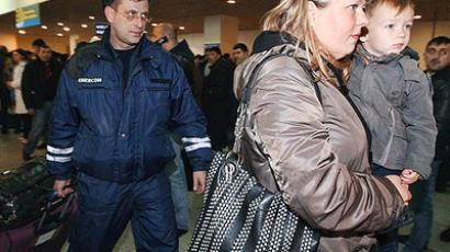 Russian citizens evacuated from Libya by the Emergency Ministry enter the arrivals zone of Domodedovo Airport in Moscow (RIA Novosti / Aleksey Kudenko)