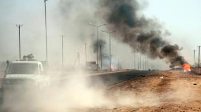 Smoke from explosions is seen during clashes between rival militias in the southern Libyan city of Sabha March 28, 2012. (Reuters/Ibrahim Azagaa)