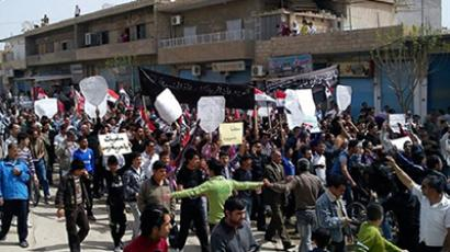 "Syrian anti-government protesters, some holding signs reading ""We only love freedom"", march in the northeastern town of Qamishli on April 1, 2011 (AFP Photo / STR)"
