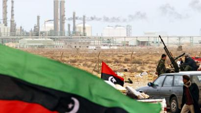 The Kingdom of Libya flag placed in front of a refinery in Ras Lanuf March 8, 2011