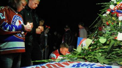 "Hockey fans at the ""Arena 2000"" stadium lay flowers and light candles in memory of the dead hockey players of the ""Lokomotiv"" team. A Yak-42 aircraft carrying the hockey team crashed on takeoff near the city's Tunoshna airport. (RIA Novosti/Konstantin Chalabov)"