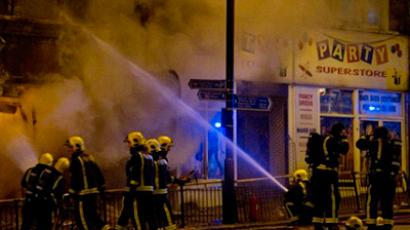 Firefighters tackle a blaze at a business in Clapham Junction, south London on 8 August 2011 (AFP Photo / Leon Neal)