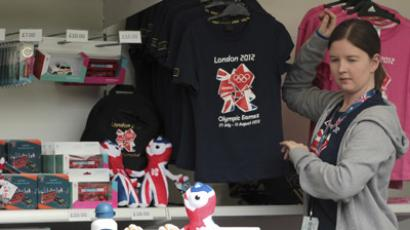 A member of staff work in a London 2012 shop selling official merchandise in Green Park, central London, July 21, 2012. (Reuters/Olivia Harris)