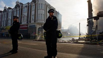 Police officers stand on High Roadin Tottenham, north London (AFP Photo / Leon Neal)