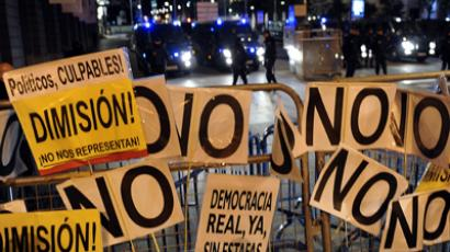 A picture taken on October 27, 2012 shows placards on a fence installed by police to protect the Spanish Congress during a protest against the government's austerity reforms and the public payment of bank's debts in Madrid (AFP Photo / Dominique Faget)