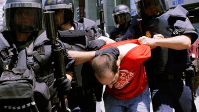 Spanish National Police officers in full riot gear detain a protester during a coal miners demonstration in Madrid May 31, 2012 (Reuters/Sergio Perez)
