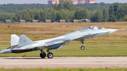 A new Russian twin-engine jet fighters T-50 lands at Zhukovsky airfield as it takes part in MAKS-2011, the International Aviation and Space Show, in Zhukovsky, outside Moscow, on August 14, 2011 (Photo from ridus-news.livejournal.com)