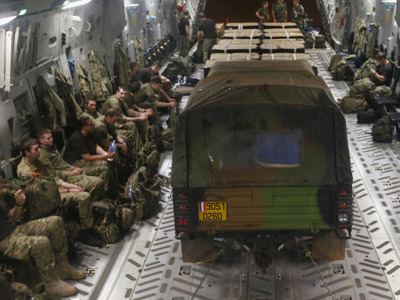A French Army Land Rover and pallets of rations are seen on a Royal Air Force C17 cargo aircraft as it prepares to leave for Bamako in Mali from Abidjan in the Ivory Coast, January 16, 2013. (Reuters/Andrew Winning)