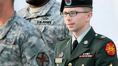 Army Private Bradley Manning is escorted away from his Article 32 hearing February 23, 2012 in Fort Meade, Maryland (Mark Wilson / Getty Images / AFP)
