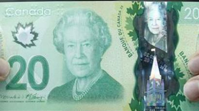 The new Canadian 20 dollar bill made of polymer is displayed at the Bank of Canada in Ottawa.(Reuters / Chris Wattie)
