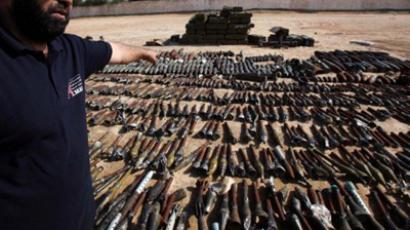 Arms and unexploded weaponry being collected in Libya, November, 2011 (AFP Photo / Mahmud Turkia)