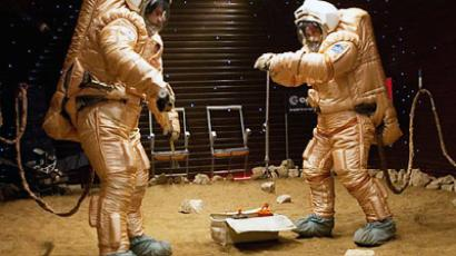 "Cosmonauts take samples of ""Martian"" soil."