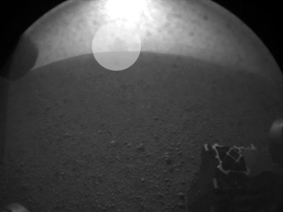 One of the first images taken by NASA's Curiosity rover with a faint blotch floating above the horizon that mysteriously vanished in later photos.  (Reuters / Courtesy NASA-JPL Caltech / Handout)
