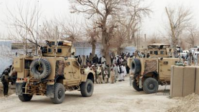 U.S. armoured vehicles are parked outside a US base in Panjwai district Kandahar province, March 11, 2012 (Reuters / Ahmad Nadeem)