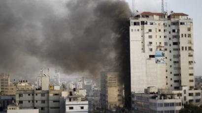 Smoke is seen after an after an Israeli air strike, witnessed by a Reuters journalist, out of a floor in a building that also houses media offices in Gaza City November 19, 2012. (Reuters/Ahmed Jadallah)