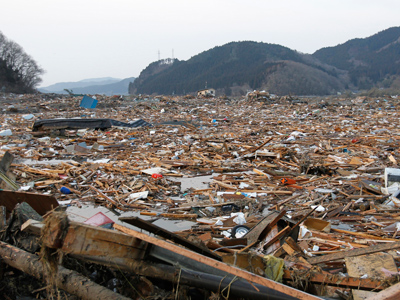 A general view shows the devastation as rescue workers search for victims in the rubble after the March 2011 magnitude 9.0 earthquake and tsunami in Rikuzentakata, northern Japan, March 13, 2011 (Reuters/Toru Hanai/Files)