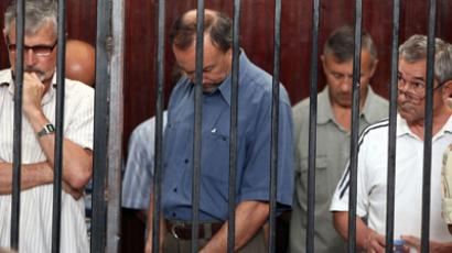 The 24 Eastern European stand behind bars in court during their trial in Tripoli on June 4, 2012 (AFP Photo / Mahmud Turkia)