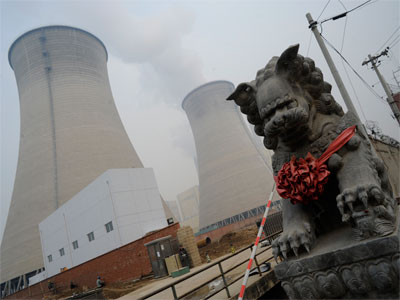 A security guard stands outside the cooling towers for a coal-powered power plant in the suburbs of Beijing. Coal burning has been a major contributing factor towards a rise in mercury emissions. (AFP Photo / Goh Chai Hin)