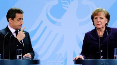 German Chancellor Angela Merkel and French President Nicolas Sarkozy arrive for a press conference following a meeting at the Chancellery in Berlin on January 9, 2012 (AFP Photo  / JOHANNES EISELE)