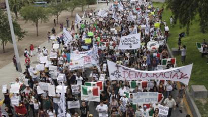 Protesters take part in a march organized by student movement Yo Soy 132 against Mexico's president-elect Enrique Pena Nieto in Monterrey July 22, 2012. (Reuters/Daniel Becerri)