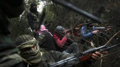 Armed Syrian men, members of the rebel Free Syrian Army (AFP Photo / Ricardo Garcia Vilanova)
