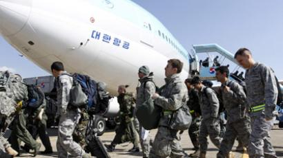 Soldiers from U.S. Kadena base in Japan arrive during their transportation drill using civilian aircrafts at a South Korean Air Force base in Daegu, about 300 km (189 miles) southeast of Seoul. (Reuters / Jo Yong hak)
