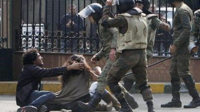 Egyptian soldiers beat-up protesters near Cairo's Tahrir Square on December 16, 2011 (AFP Photo / Mohammed Abed)