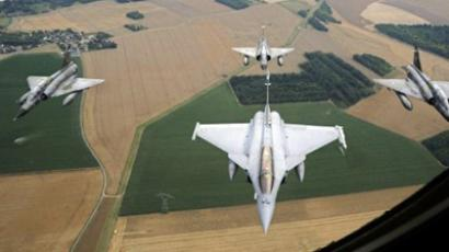 A French Rafale jet flanked by three Mirage 2000-N (AFP Photo / Anne-Christine Poujoulat)