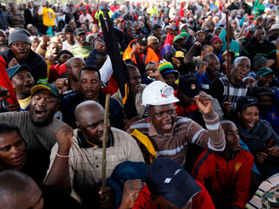 Striking workers take part in a march at Emalahleni, 100km (60 miles) east of Johannesburg, July 28, 2011.(REUTERS / Siphiwe Sibeko)