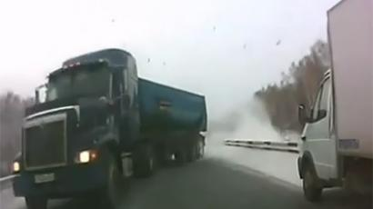 Driver's miracle escape on snow-bound Russian highway