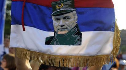 BELGRADE : A protestor holds a flag with a picture of Ratko Mladic. (AFP Photo / Andrej Isakovic)