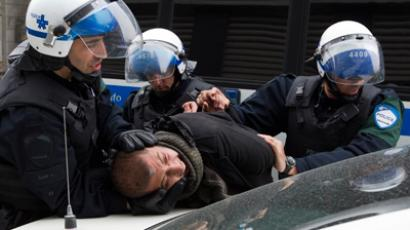 A protestor is arrested by police after a student demonstration against tuition hikes in Montreal on April 20, 2012 (Reuters / Christinne Muschi)