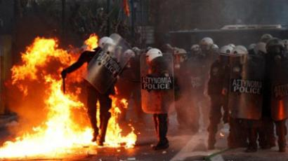 Protesters throw petrol bombs at riot police in front of the Greek Parliament in Athens on February 12, 2012 (AFP Photo / Angelos Tzortzinis)