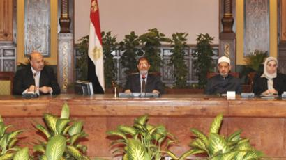 Egypt's President Mohamed Mursi  attends a meeting with other politicians and heads of parties at the presidential palace in Cairo December 8, 2012. (Reuters)