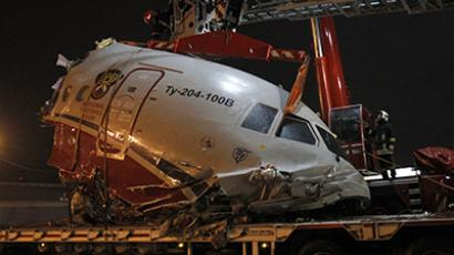 A plane wreckage is removed from a highway near Moscow's Vnukovo airport December 29, 2012. (Reuters/Sergei Karpukhin)