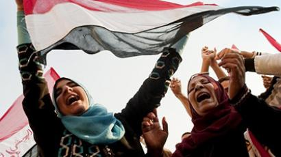Cairo: Egyptians dance as they celebrate at Cairo's Tahrir Square. (AFP Photo / Pedro Ugarte)