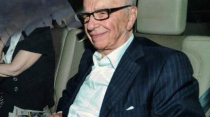 News Corp chief Rupert Murdoch arrives at his home in Westminster on July 11, 2011 in London. (AFP Photo/Andrew Cowie)