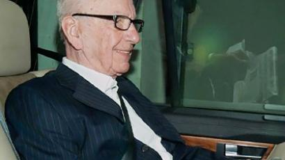News Corporation Chief Rupert Murdoch leaves his London home in a car on July 13, 2011 (AFP PHOTO / Ki Price)