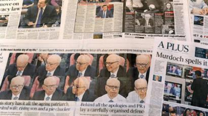 The generval view shows newspapers with coverage dominated by Rupert Murdoch's appearance before a British parliamentary committee (AFP Photo / William West)