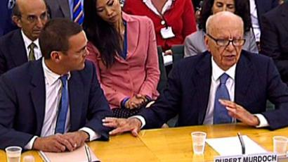 News Corporation Chief Rupert Murdoch (Front R) and his son James  give evidence to a Parliamentary Select Committee on the phone hacking scandal July 19, 2011(AFP Photo / Ki Price)