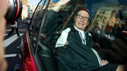 London : News Corp chief Rupert Murdoch leaves his London home on July 11, 2011. (AFP Photo / Leon Neal)