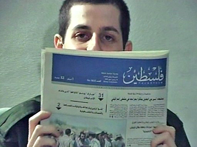 An image grab from a video released on October 2, 2009 by the Israeli authorities of Gilad Shalit holding up a Gaza newspaper dated September 14, 2009 (AFP PHOTO/AFP TV)