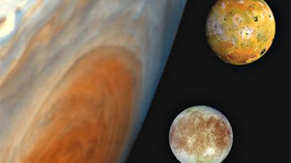 "This composite ""family portrait"" from NASA's website shows Jupiter with two of its four largest moons: Io, on the top, and Europa (Photo from http://www.nasa.gov/)"