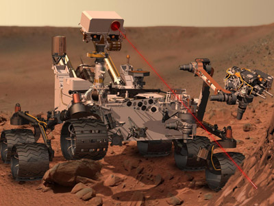 This artist's concept depicts the rover Curiosity, of NASA's Mars Science Laboratory mission, as it uses its Chemistry and Camera (ChemCam) instrument to investigate the composition of a rock surface. (Reuters/NASA/JPL-Caltech/Handout)