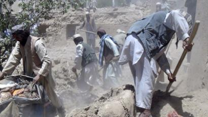 Afghan men search for the bodies of people killed in a NATO airstrike in Logar province June 6, 2012. (Reuters/Stringer)