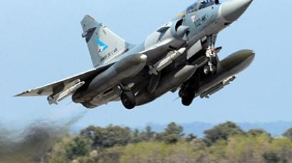A Mirage 2000-5 jet fighter takes off at the aerial military base 126 - Capitaine Preziosi aka Solenzara base, in Ventiseri, on the French Mediterranean island Corsica, for a mission in Libya on March 24, 2011 (AFP Photo / Stephan Agostini)