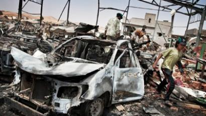 Libyans inspect the damage at a factory targeted by NATO air strikes in Bir Ghanam on August 6, 2011 as rebel forces said they captured the town, 80 kilometres (50 miles) southwest of the Libyan capital Tripoli, from fighters loyal to Gaddafi (AFP Photo / Colin Summers)