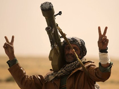 A Libyan rebel with a SAM-7 flashes victory signs in Ajdabiya (AFP Photo / Patrick Baz)