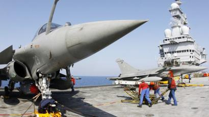 A Mica missile is installed on a Rafale fighter jet on the flight deck of NATO's flagship Charles de Gaulle aircraft carrier March 27, 2011